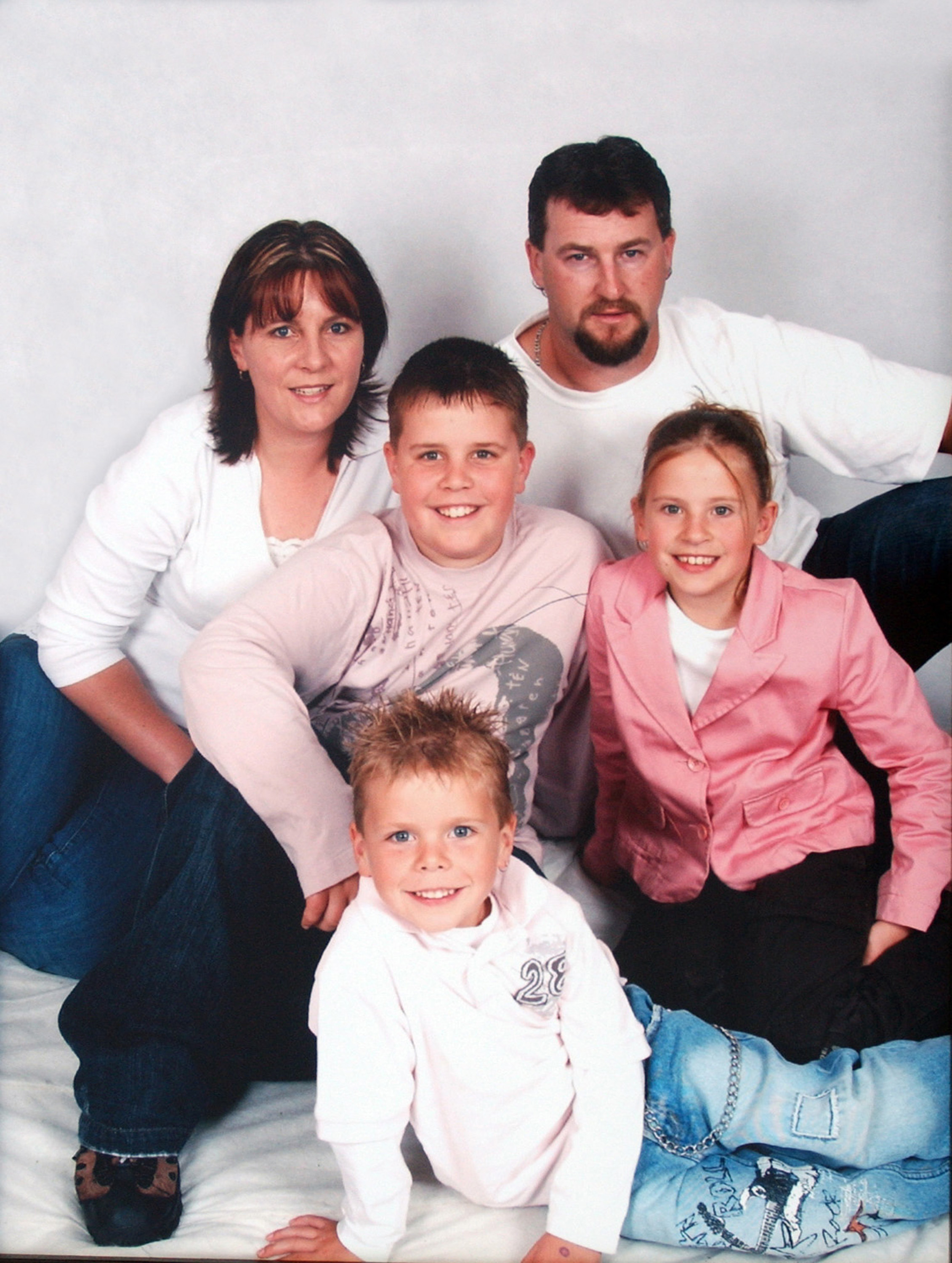 Todd Russell (top right) Carolyn, Liam, 5 (bottom), Trent, 11 (center) and Madison, 9. (AAP)