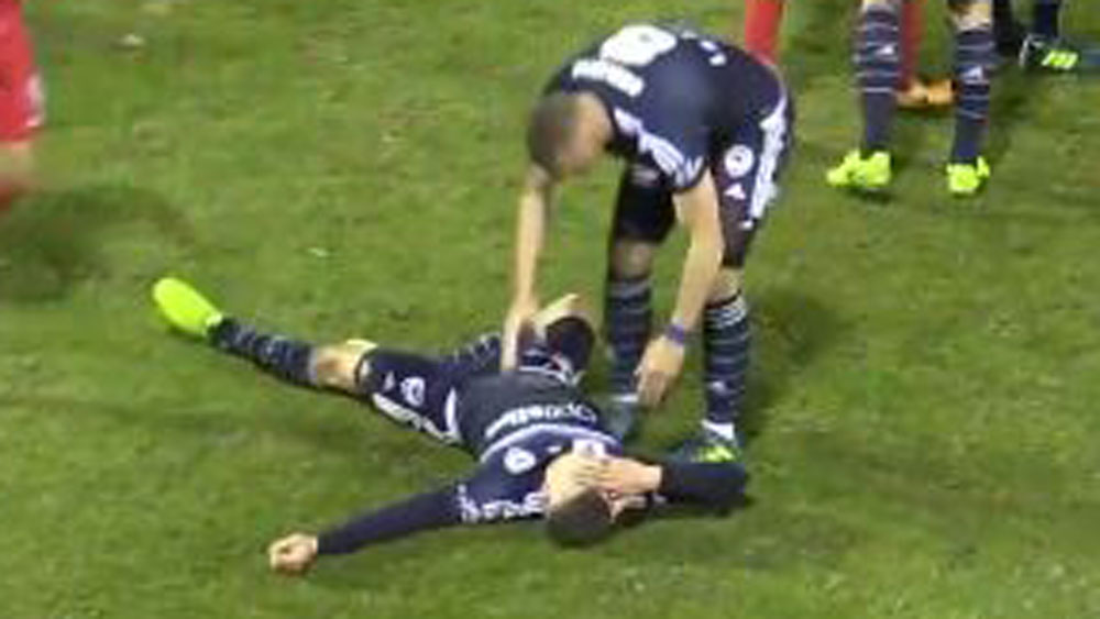 Melbourne Victory player Mitch Austin was flattened by a shoulder charge. (Fox Sports)