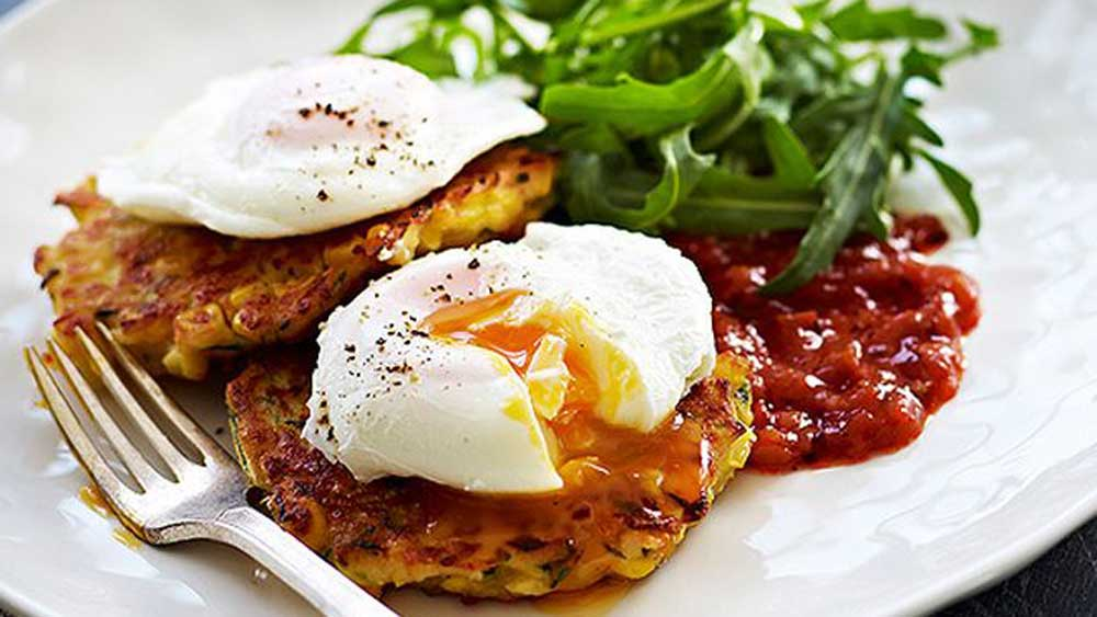 Cheesy corn and zucchini fritters and eggs