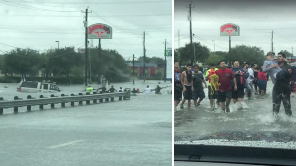 A human chain pulls an elderly man from a flooded SUV. (Stephanie Edward Mata)