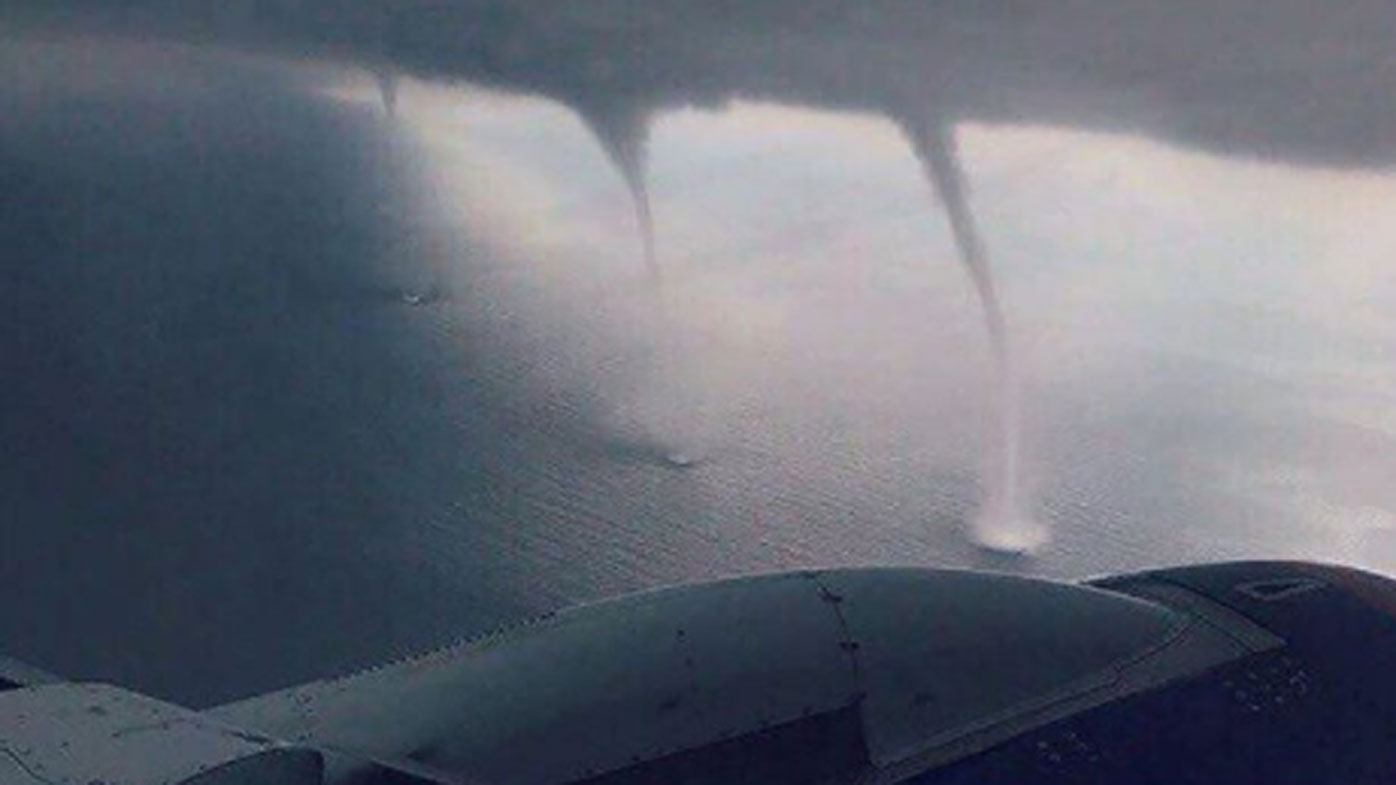 A passenger aboard the flight snapped this photo of the waterspouts. (Instagram)