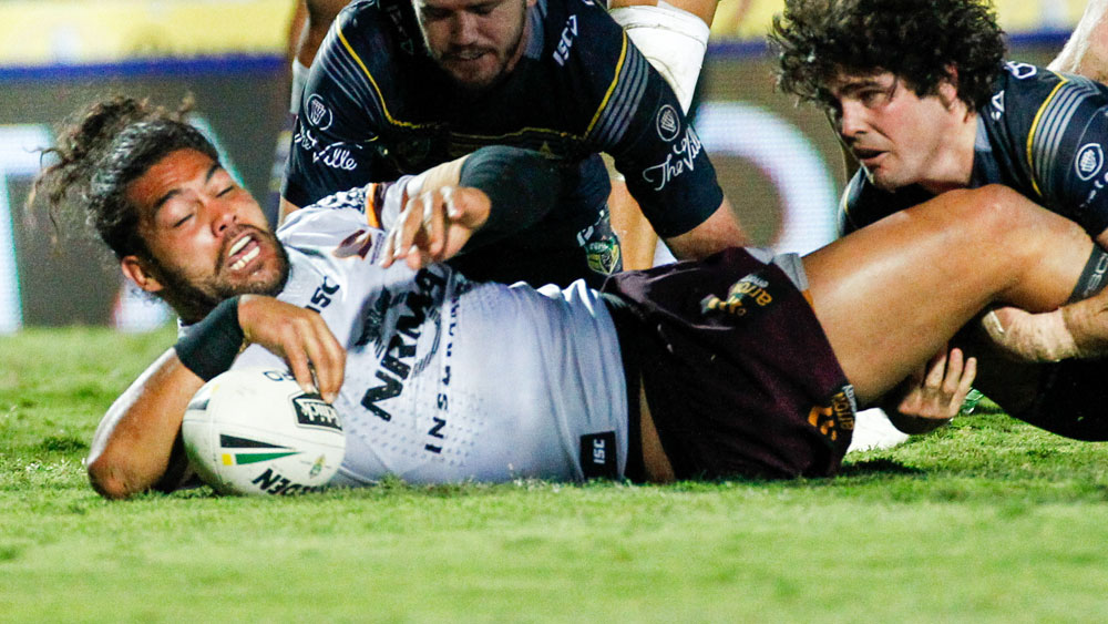 Adam Blair crashes over for the Broncos against the Cowboys. (AAP)