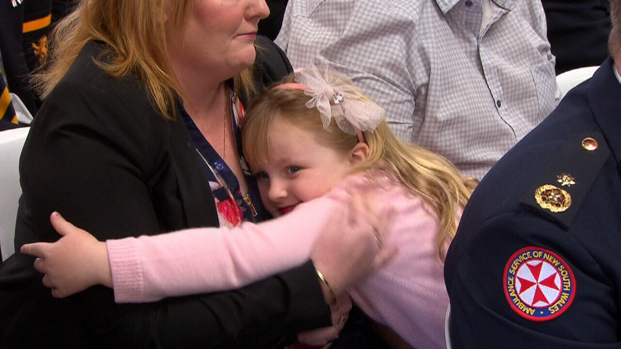 Georgia Ritter hugged her mother before walking onstage to pick up her award. (9NEWS)