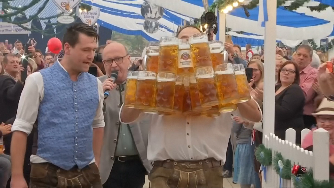 The world record for carrying beer steins now stands at 29.