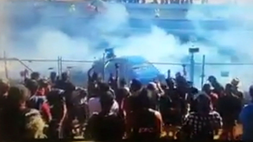 Racing spectators were 'sprayed with fuel'. (9NEWS)