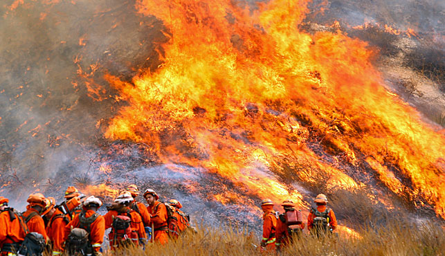California firefighters battle to build the wildfire near LA under control. (Associated Press).