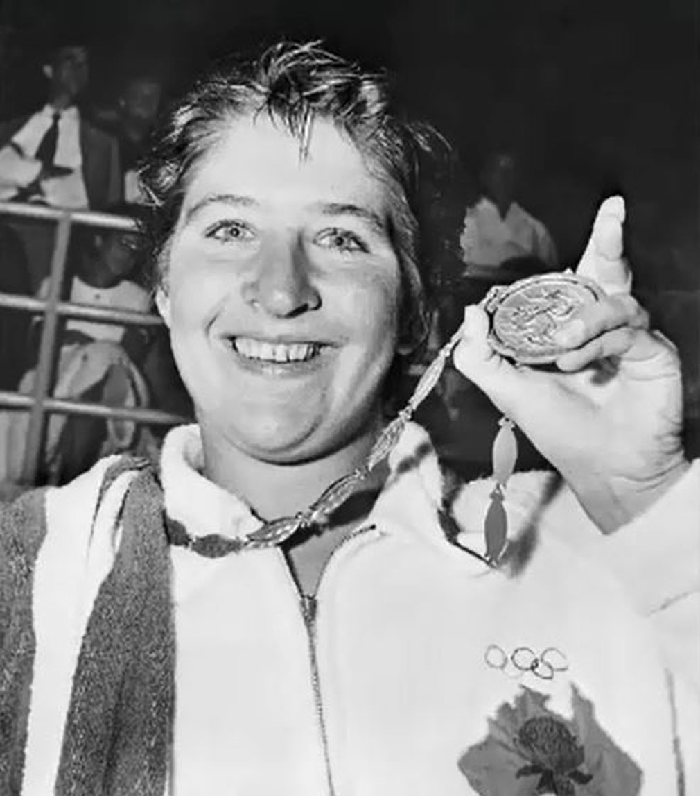 Fraser shows off a gold medal from the 1960 Rome Olympics. (Source: Getty)