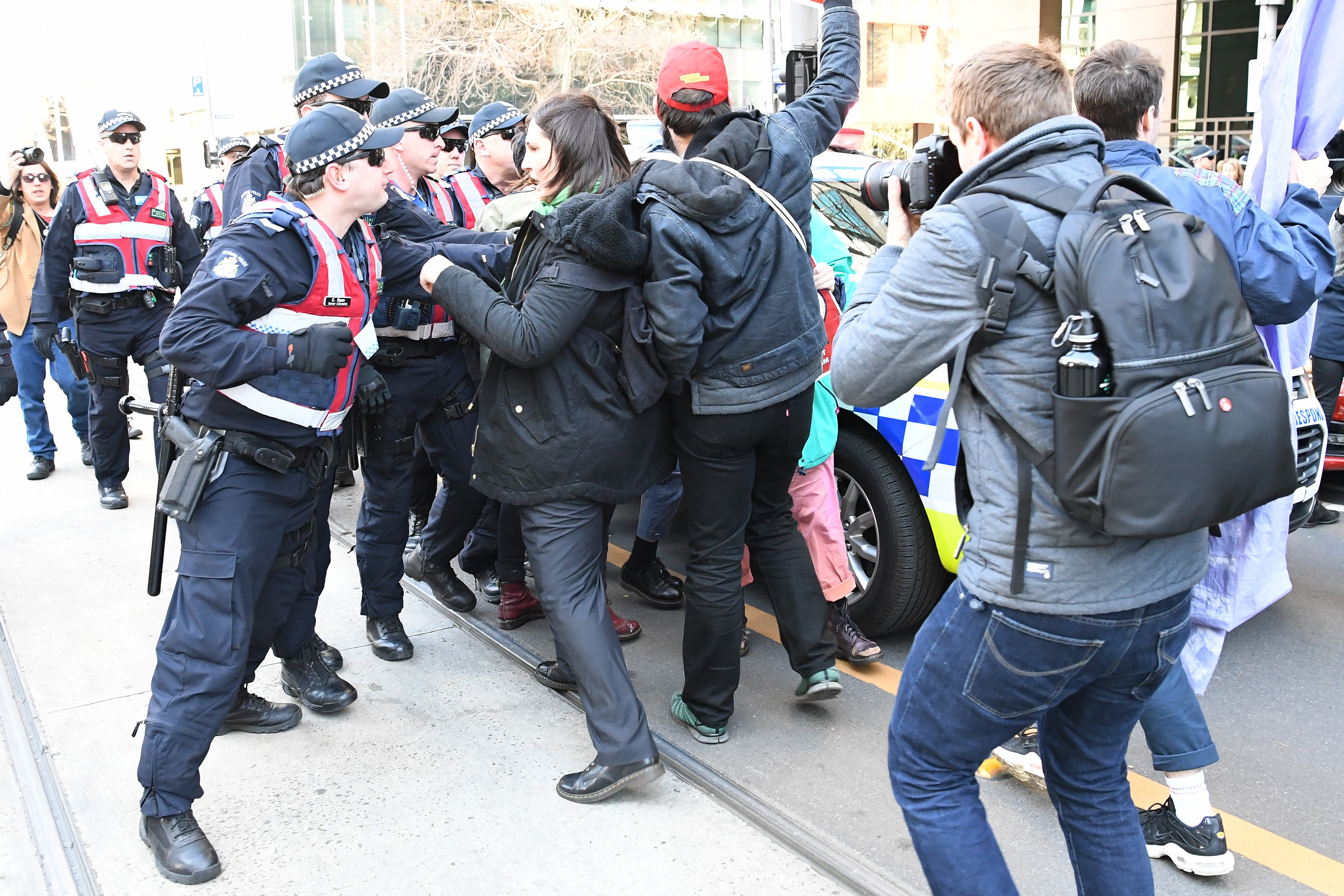 Members of the rally clashed with a wall of police officers. (AAP)