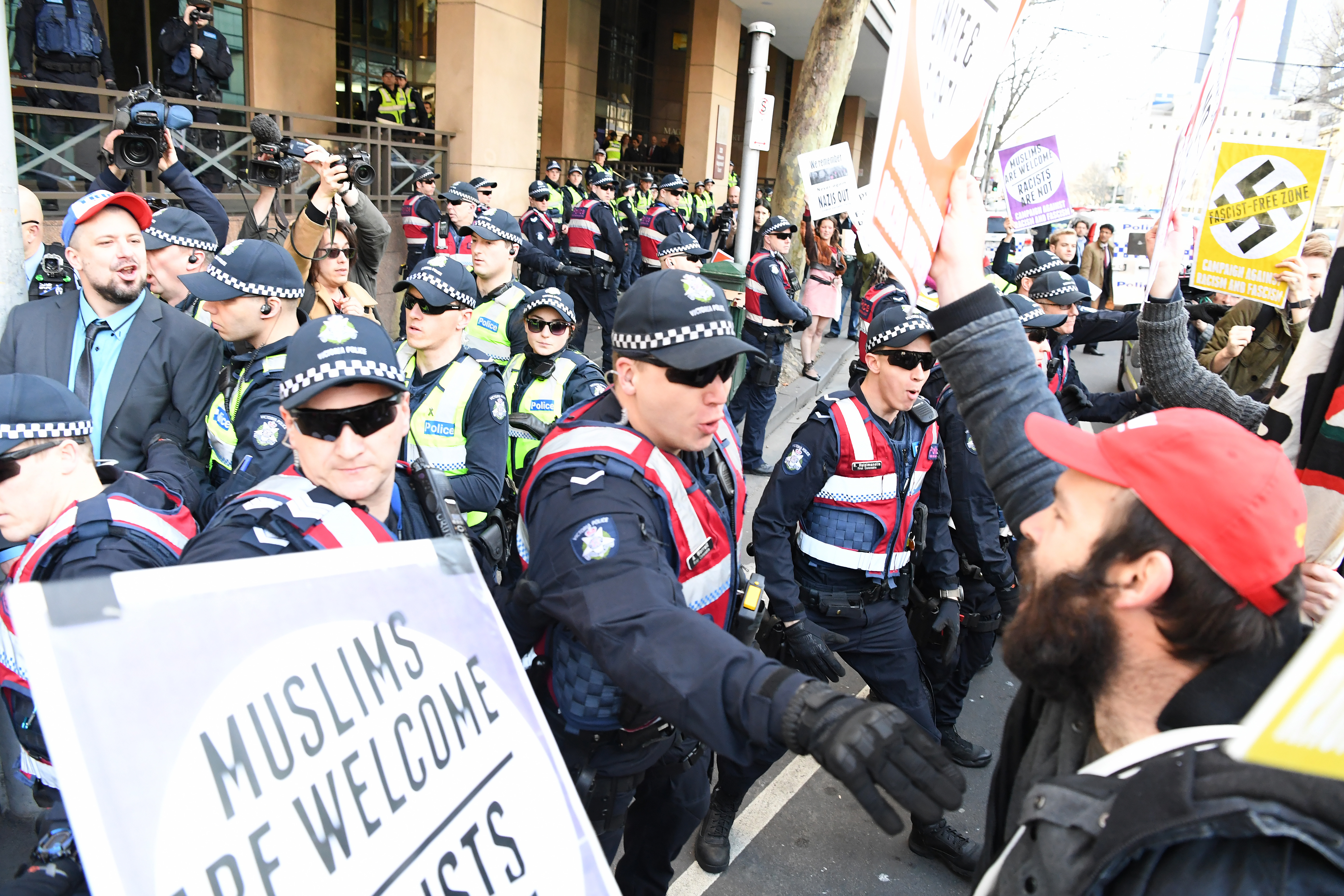 Chaotic scenes outside the Melbourne Magistrates Court. (AAP)