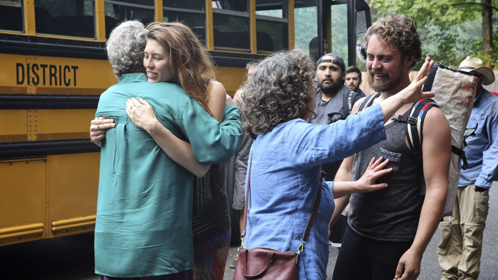 Families reunite after campers were evacuated from a forest fire in the Eagle Creek area of the Columbia River Gorge. (Associated Press)