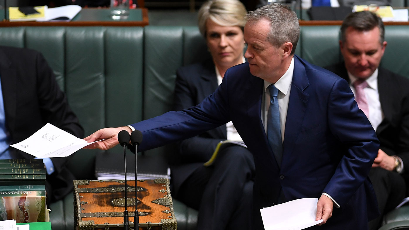 Australian Opposition Leader Bill Shorten tables the renunciation of his British citizenship at the end of House of Representatives Question Time at Parliament House.  (AAP)