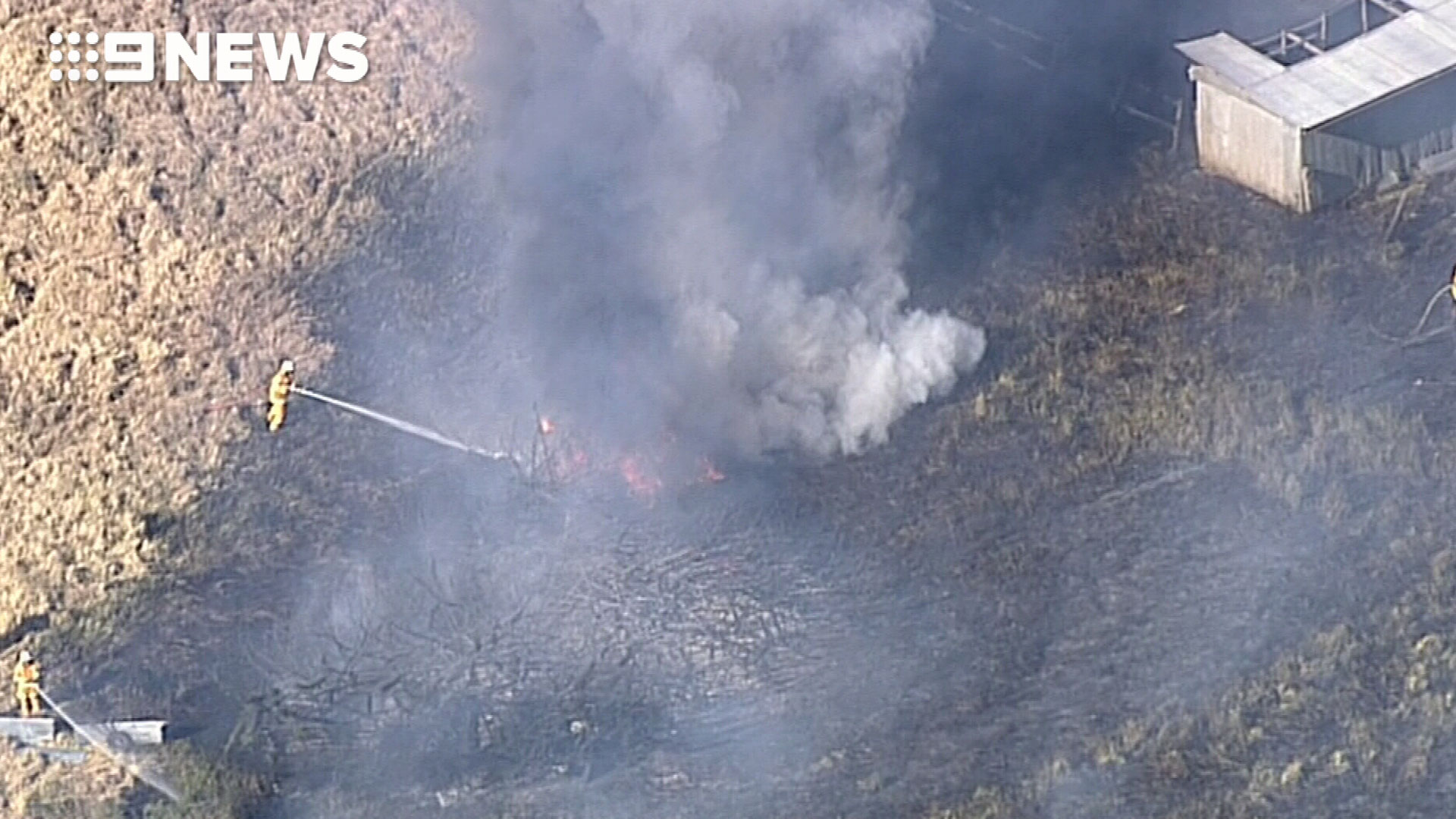 The grass fire is not expected to impact any homes in the area. (9NEWS)