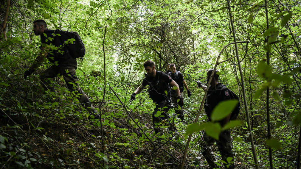 A search team on the hunt for the missing girl. (AFP)