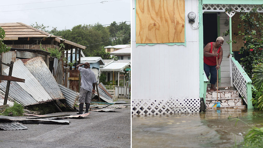 A man surveys the wreckage on his property and a woman pushes out floodwaters on her property after the passing of Hurricane Irma, in St. John's, Antigua and Barbuda. (AP)