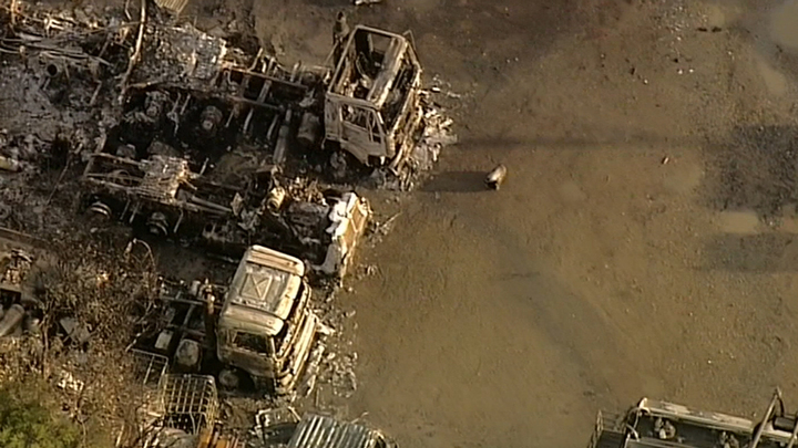 The charred remains of trucks. (9NEWS)
