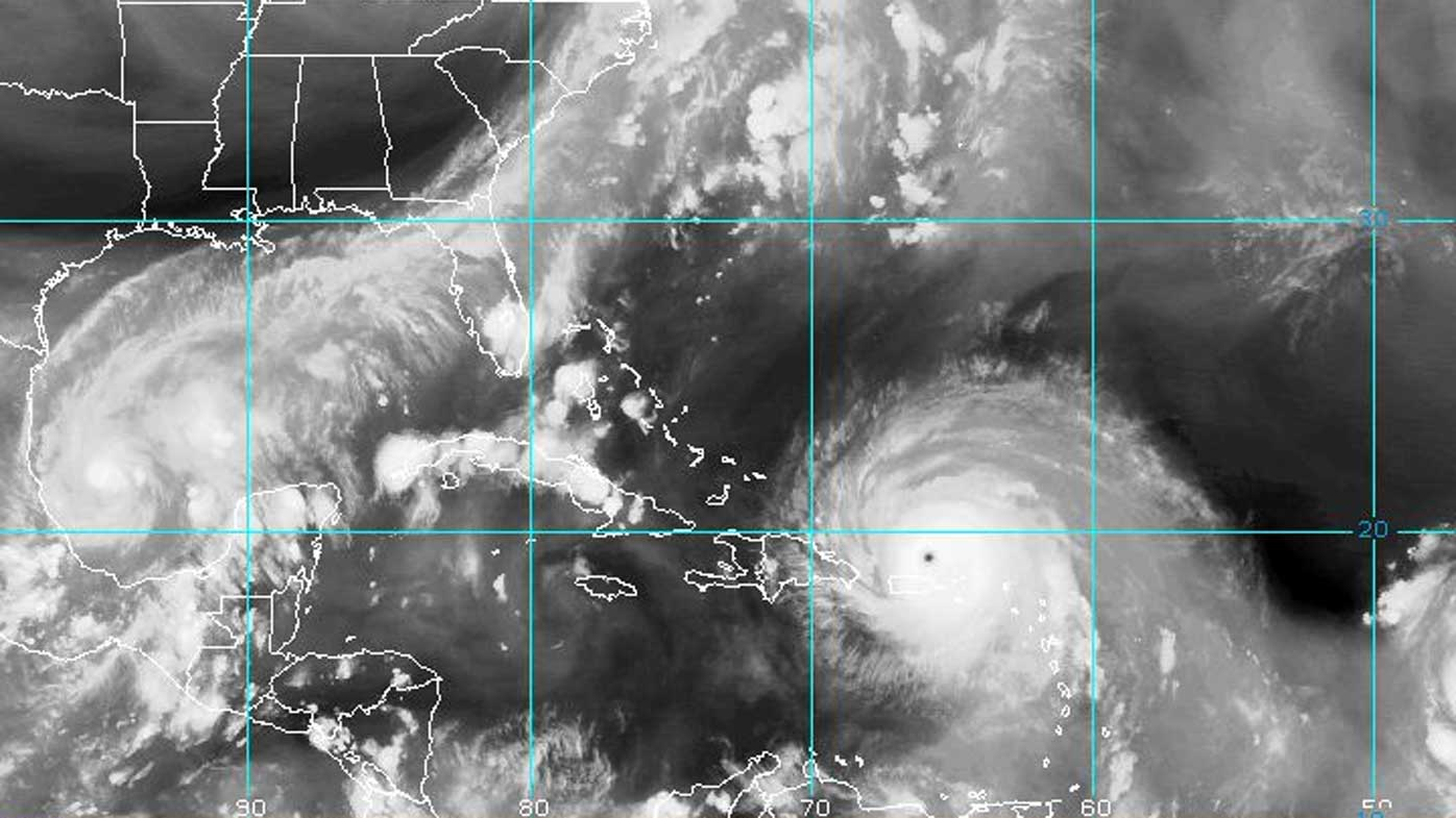 A satellite photo shows the sheer size of Irma, with Katia forming to the far left. (NOAA)