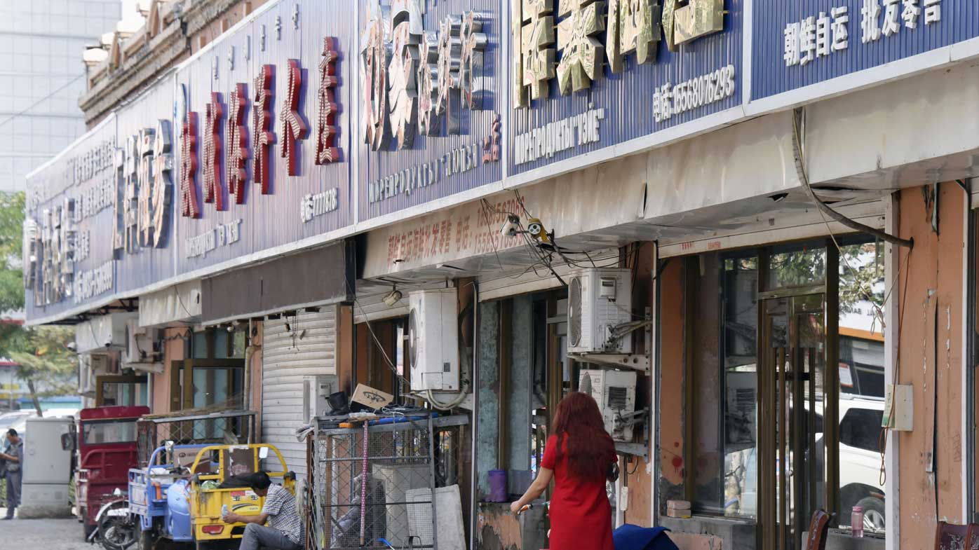 A shop selling North Korean seafood in the Chinese border town of Hunchun. (AAP)