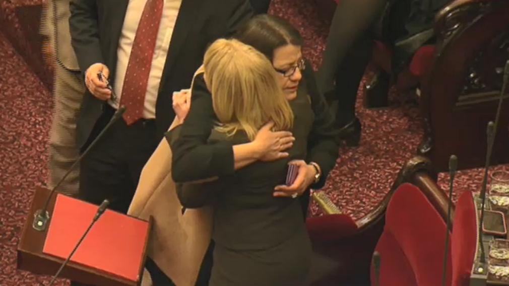 Fellow MPs hugged Ms Carling-Jenkins after she made her powerful speech. (9NEWS)