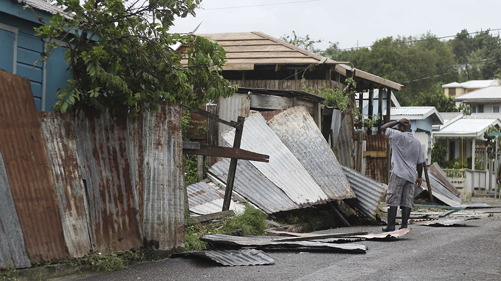 A man surveys the wreckage on his property after the passing of Hurricane Irma, in St. John's, Antigua and Barbuda. (AAP)