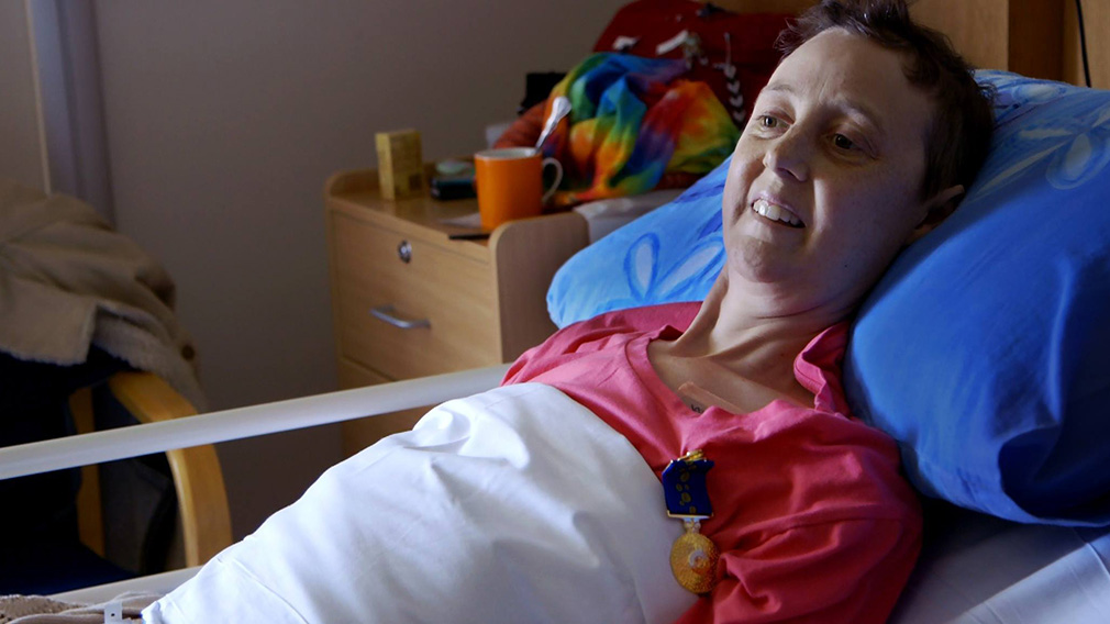 Connie wearing her medal of the Order of Australia in her hospice bed in Canberra. (Love Your Sister)