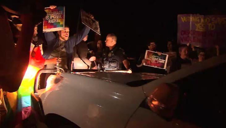 The protest became violent. (9NEWS)