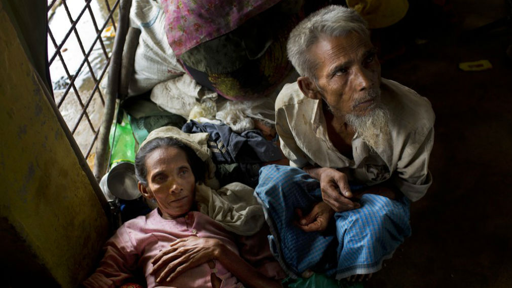 Newly arrived Rohingya Jamie Hasan, right, and his wife Hag Bano rest inside a school in Kutupalong refugee camp, Bangladesh. (AP)