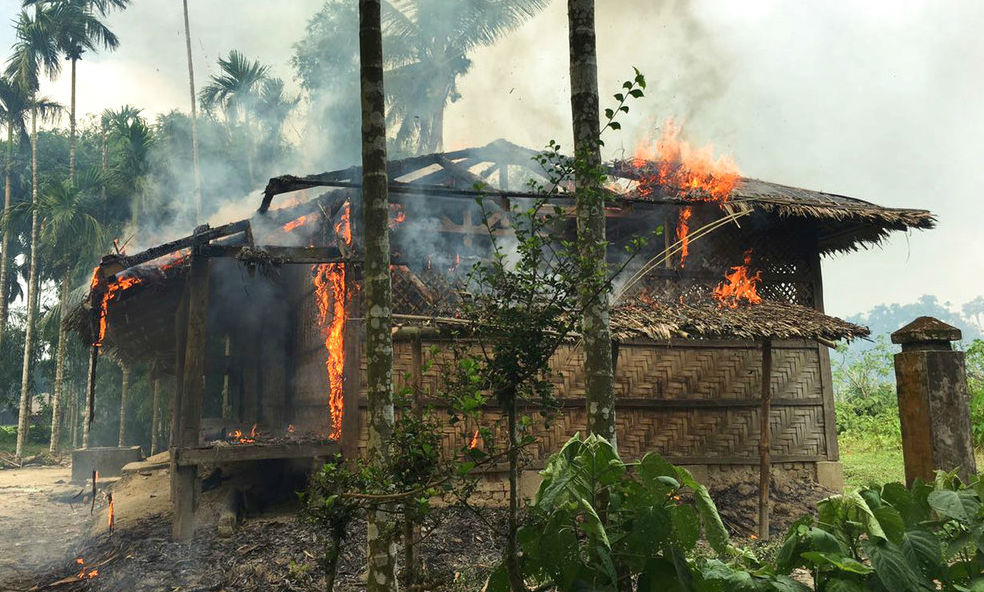 Houses are on fire in Gawdu Zara village, northern Rakhine state, Myanmar, Thursday, Sept. 7, 2017. Journalists saw new fires burning Thursday in the Myanmar village that had been abandoned by Rohingya Muslims. (AP)