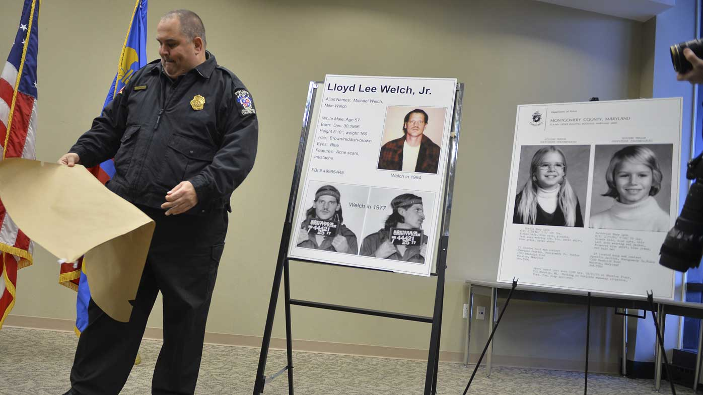 In this Feb. 11, 2014 file photo, Montgomery County Police Officer Robert Ladan uncovers photos of Lloyd Lee Welch Jr. (AP)