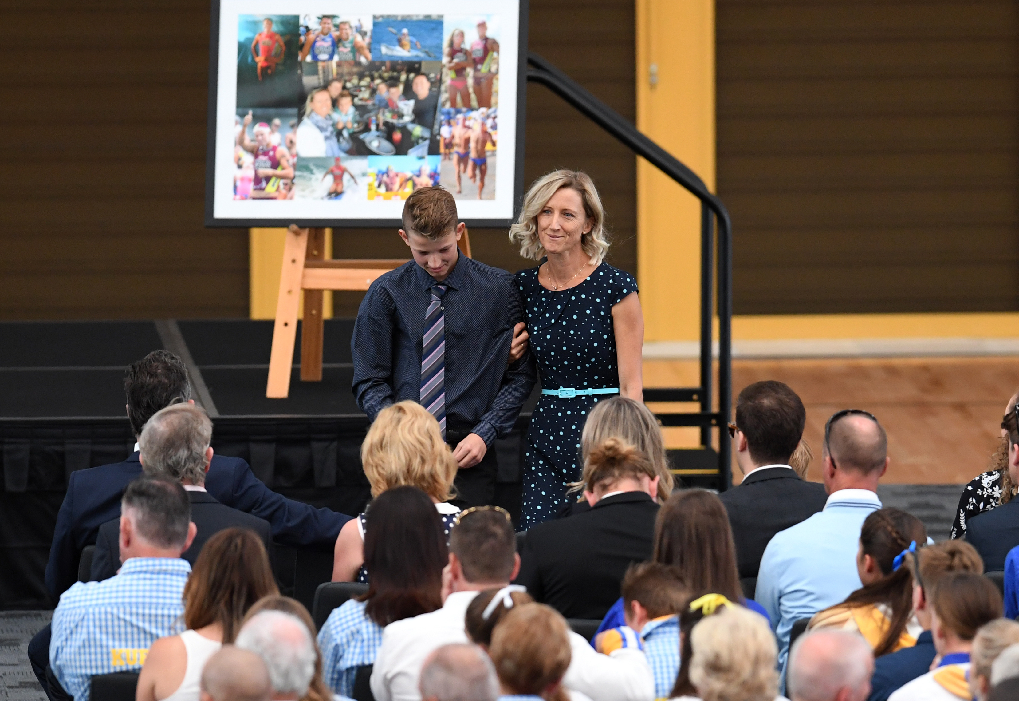 Reen Mercer and her son Brayden read a tribute during a memorial service for their husband and father Dean Mercer on the Gold Coast. (AAP)