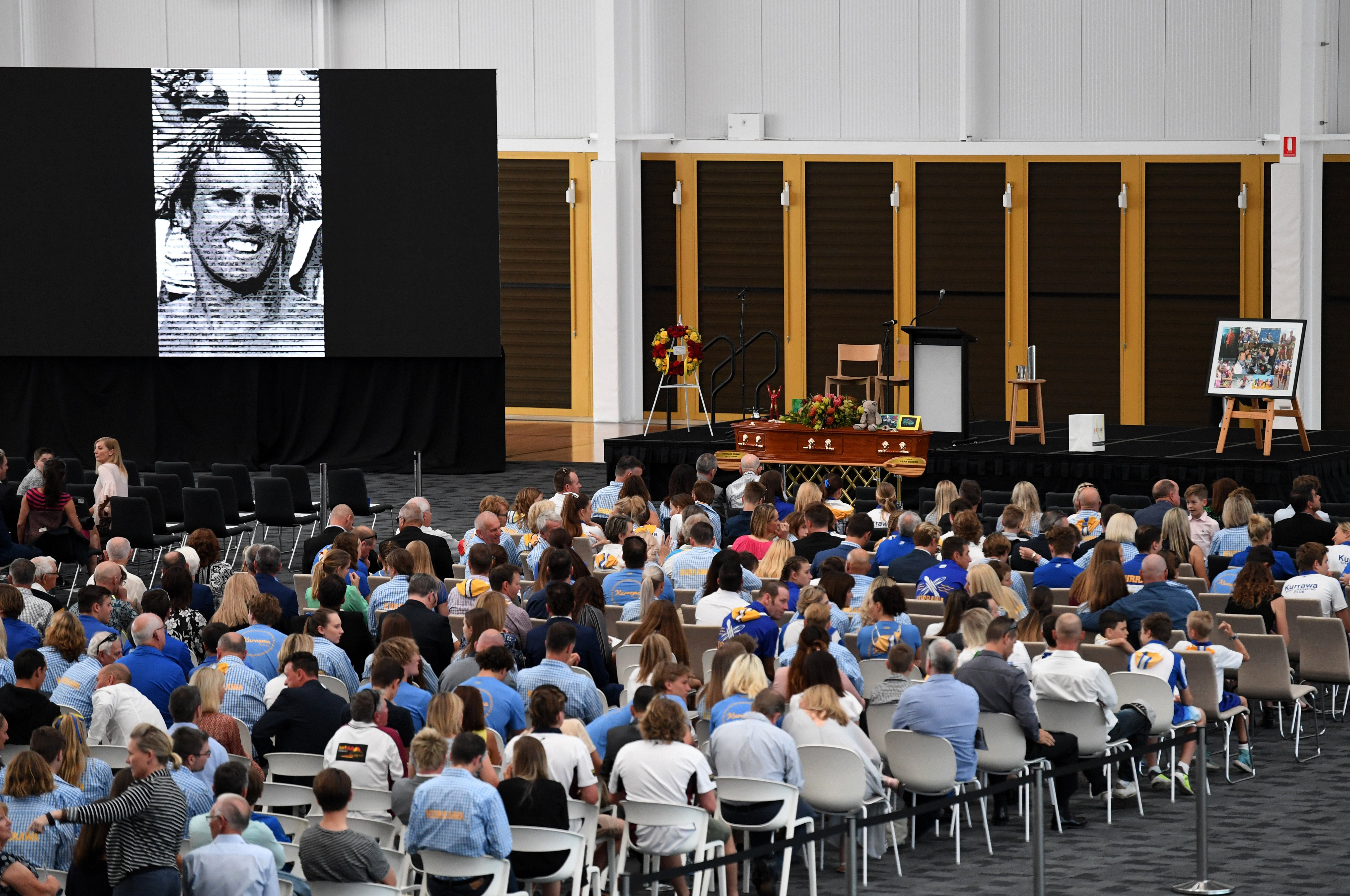 Mourners attend the memorial service for Dean Mercer on the Gold Coast. (AAP)