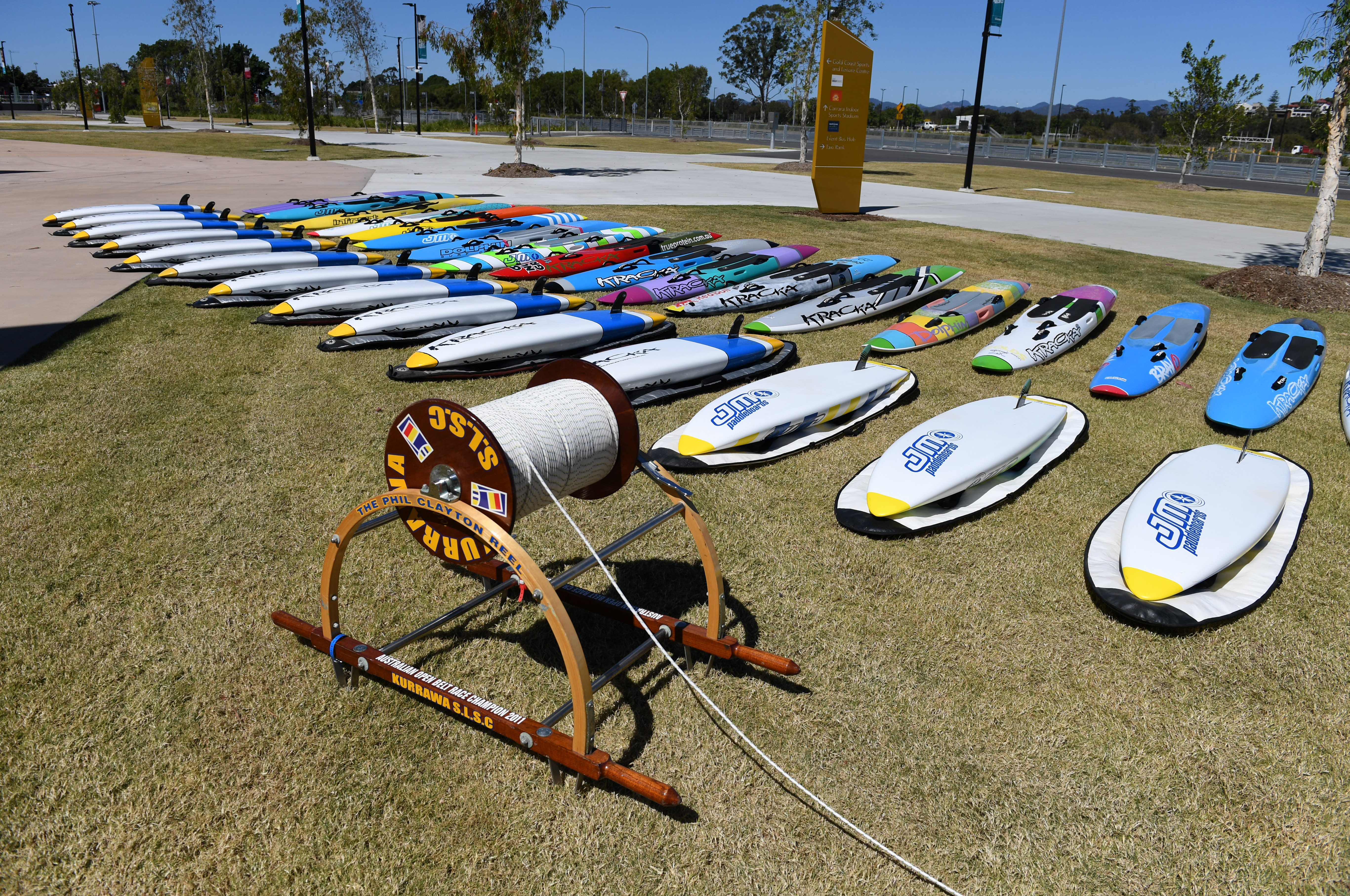 A vintage surf reel and surf boards are on display at the entrance to the memorial service for Dean Mercer on the Gold Coast. (AAP)
