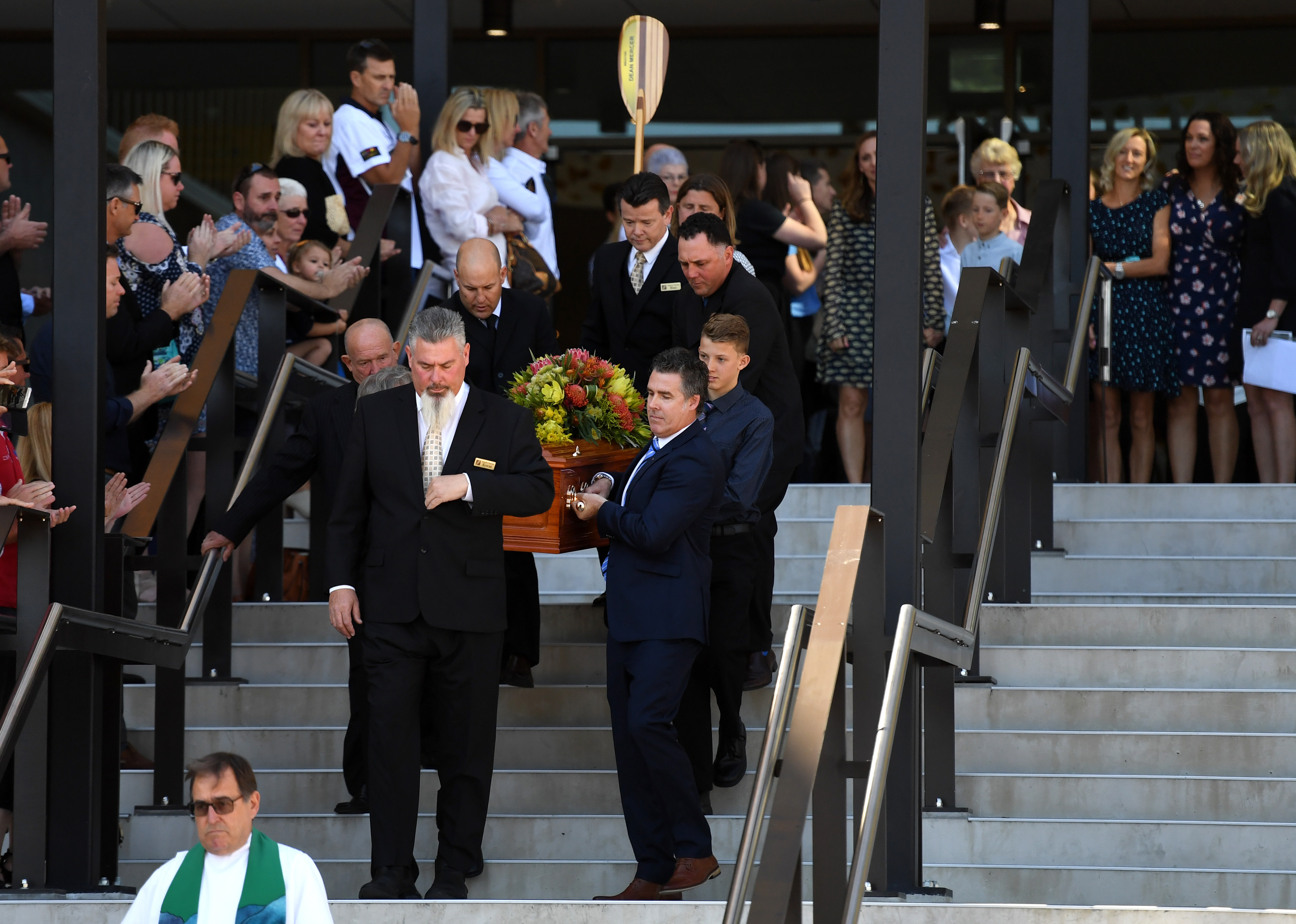 Pall-bearers, including 13-year-old Brayden, carry the coffin of his father Dean Mercer. (AAP)