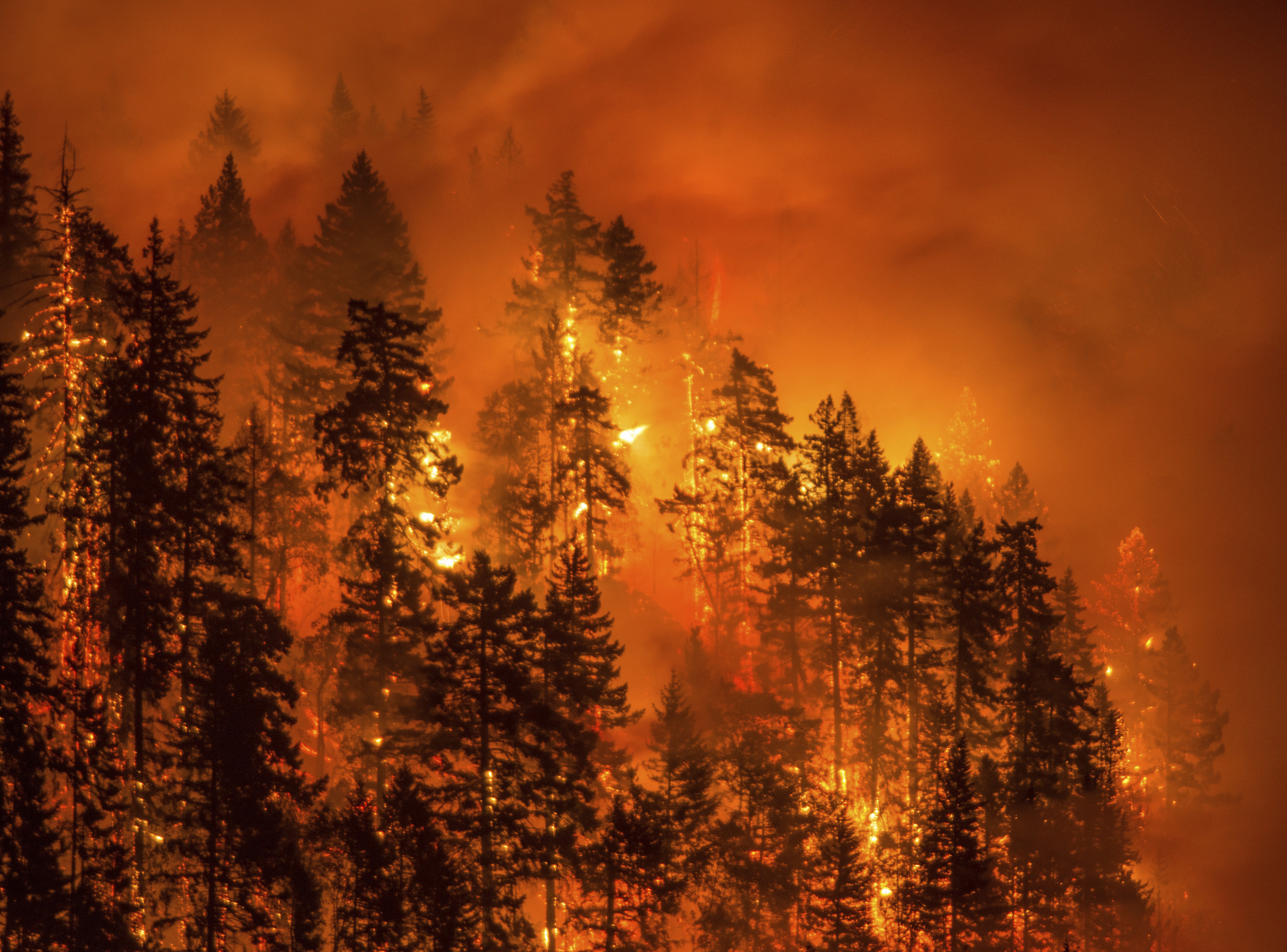 A wildfire as seen from near Stevenson Wash., across the Columbia River, burning in the Columbia River Gorge. (AAP)