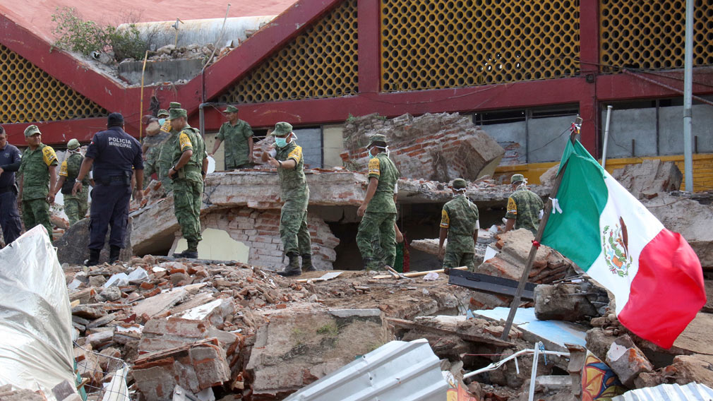 Soldiers remove debris from a partly collapsed municipal building felled by a massive earthquake in Juchitan, Oaxaca state, Mexico. (AP)