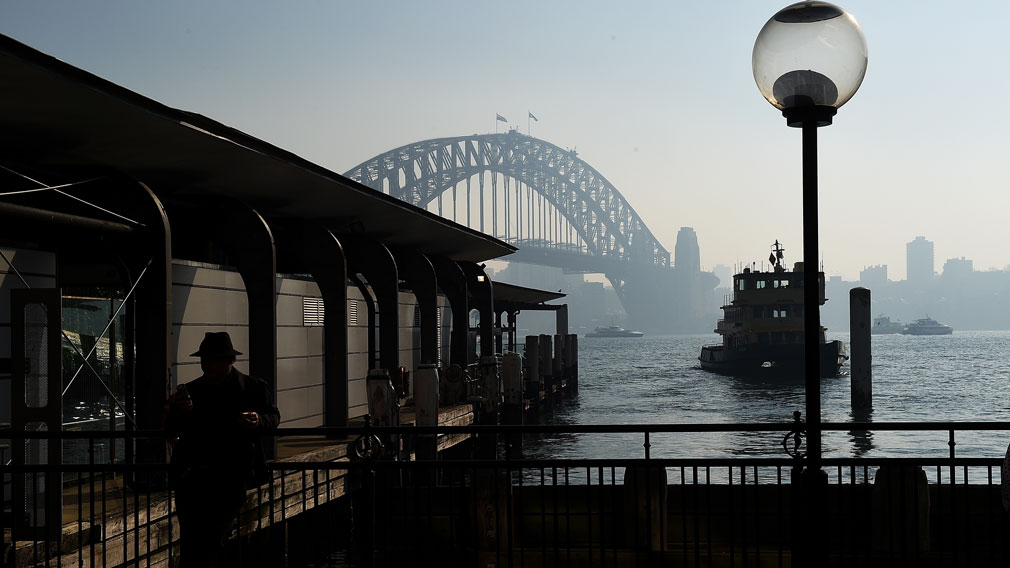 The Sydney Harbour Bridge, seen through a smoke haze from hazard reduction burns across the state of New South Wales, as seen from Circular Quay, in Sydney on May 22, 2016. (AAP)