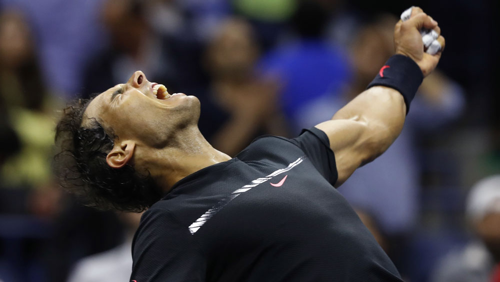 Rafael Nadal celebrates his semi-final win over Juan Martin del Potro. (AAP)