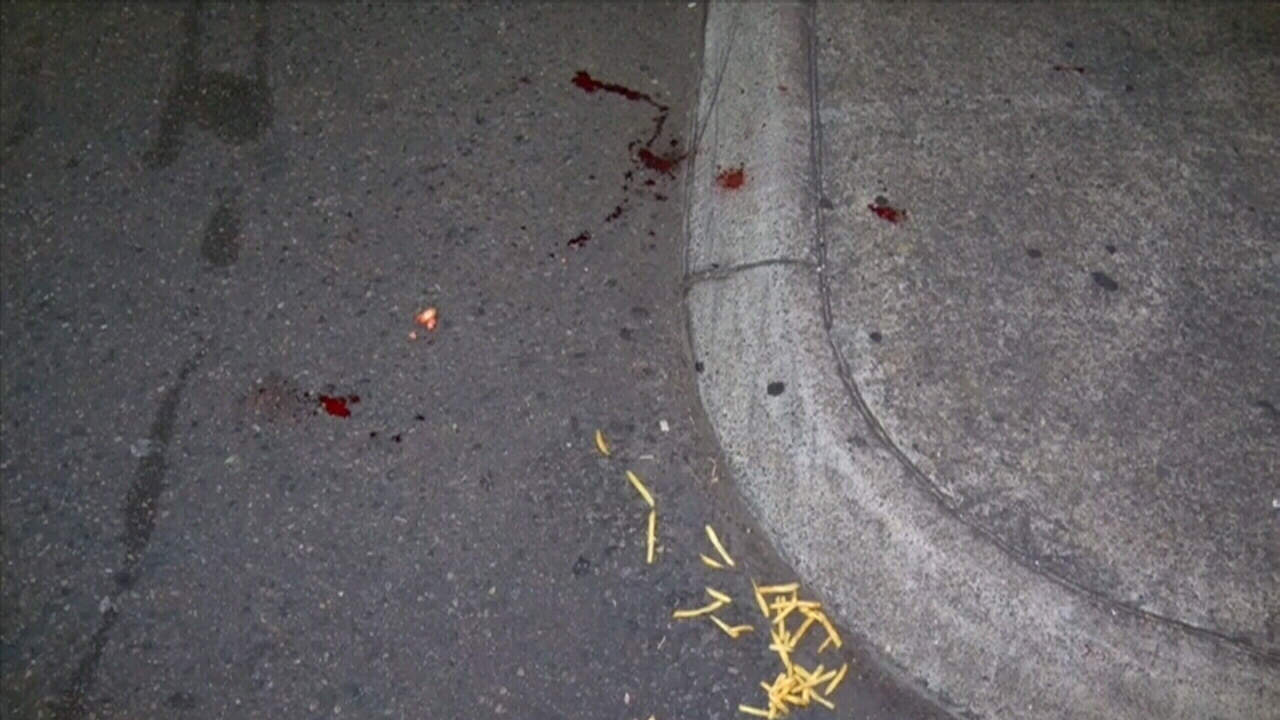 Blood and fast-food at the scene. (9NEWS)
