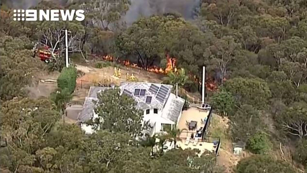 The fire which threatened a home in Beacon Hill, on the northern beaches, yesterday.