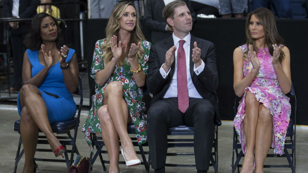 Omarosa Manigault Eric Trump the son of President Donald Trump and his wife Lara Trump and first lady Melania Trump sit to the side of the stage as President Donald Trump speaks during a Make America Great Again rally
