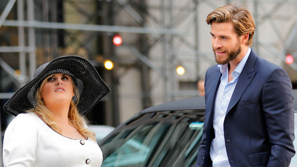 """Liam Hemsworth and Rebel Wilson on the set of """"Isn't It Romantic"""" in New York City. (AAP)"""