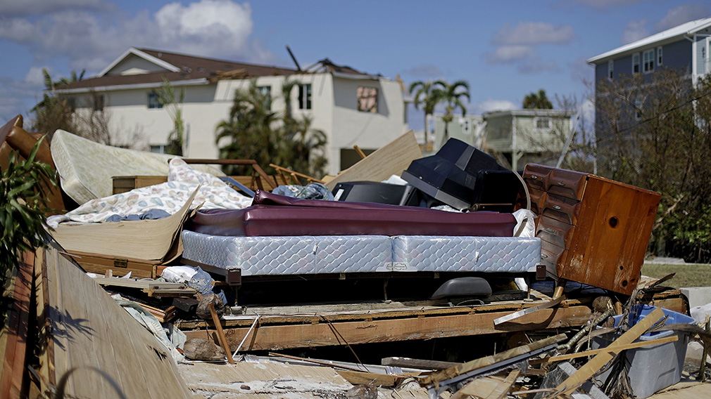 A bed sits amongst the remains of its room in a home demolished from Hurricane Irma in Goodland. (Associated Press)