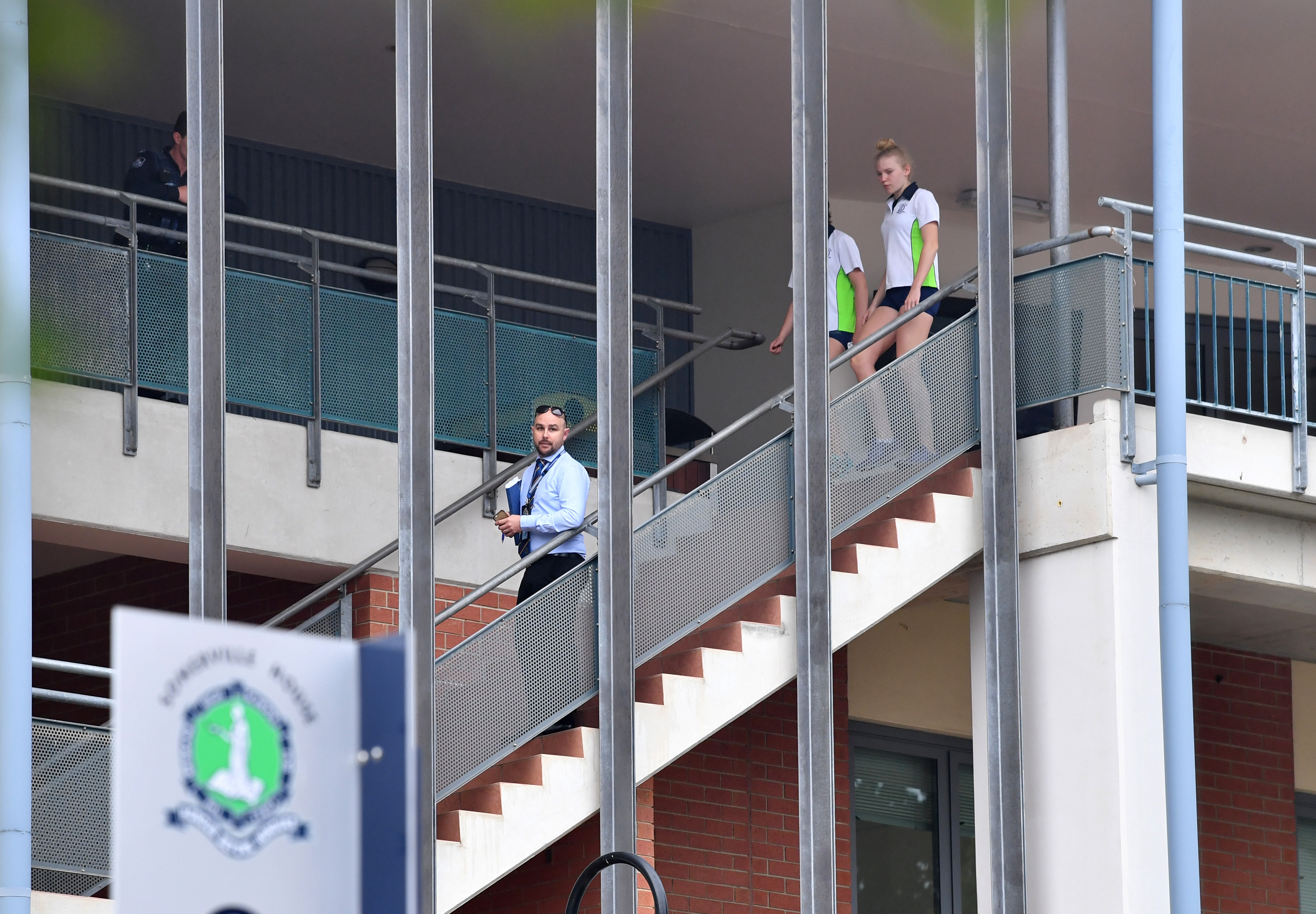 Officers have been at the Brisbane school through the morning. (AAP)