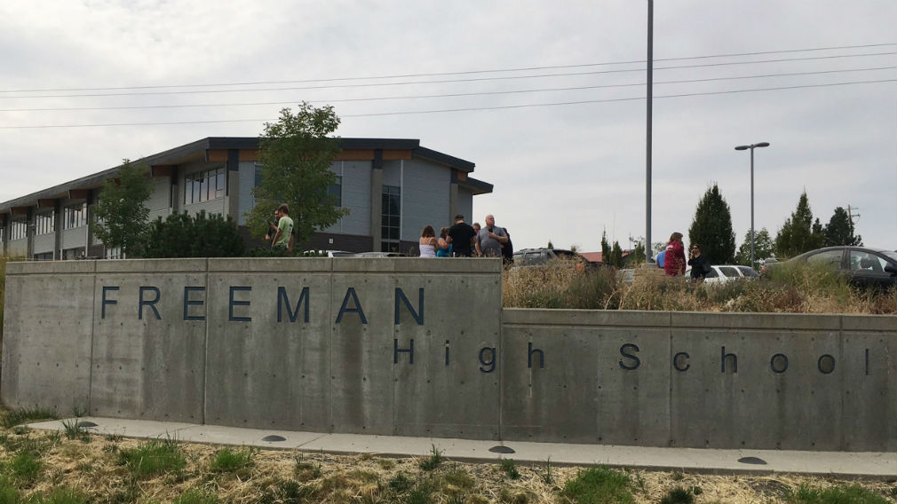 People gather outside of Freeman High School after reports of a shooting at the school in Rockford Washington