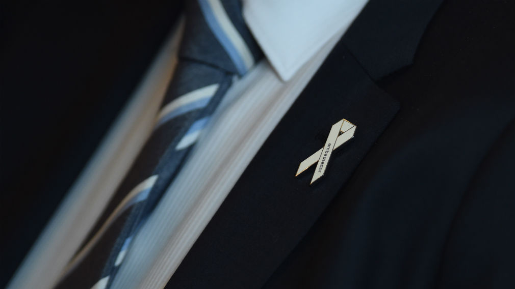 A White Ribbon pin. (AAP)