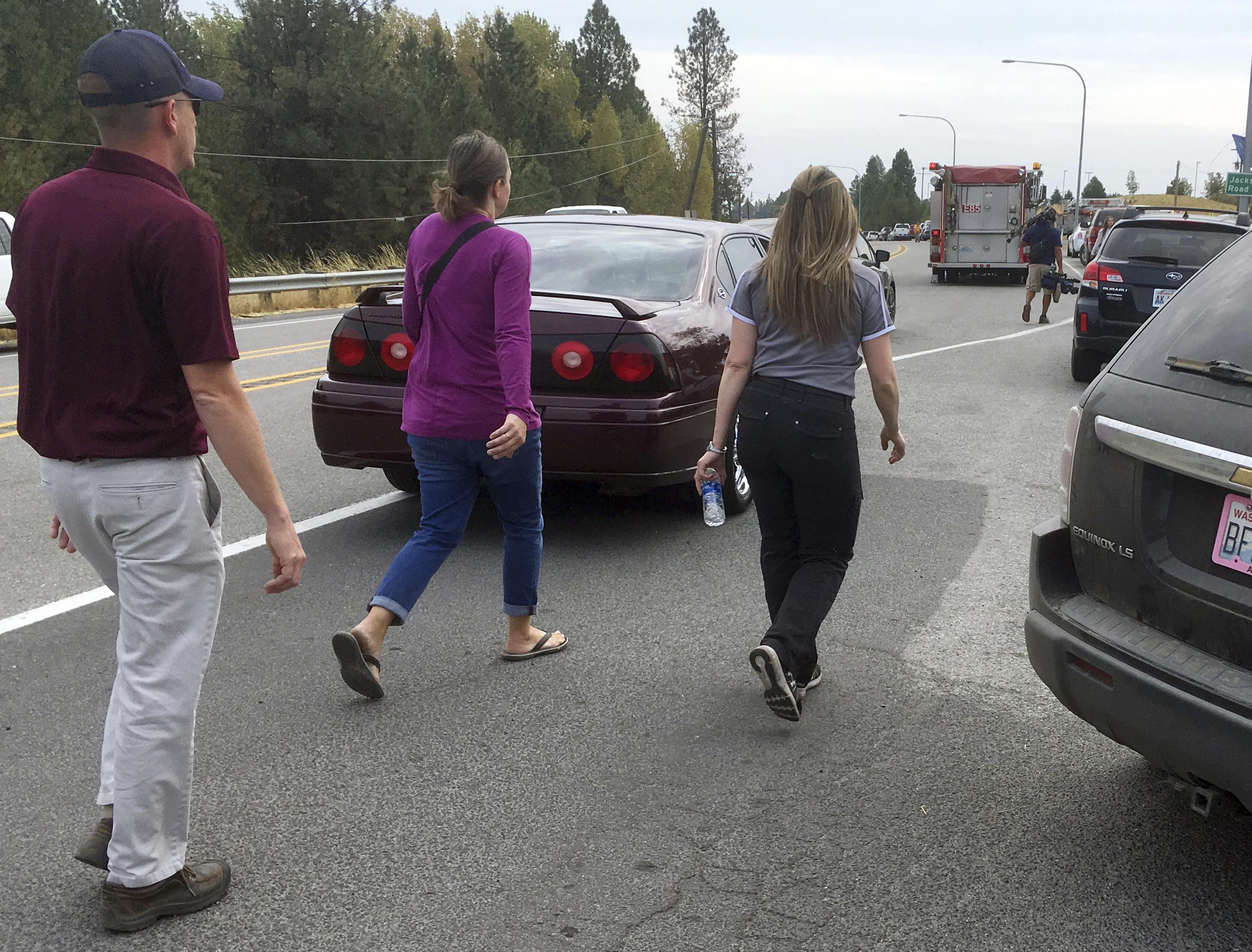 People hurry toward Freeman High School. (AP)