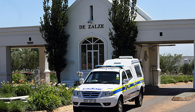 A police vehicle outside the exclusive gated housing estate near Cape Town where the van Breda family lived. (Photo: AP).