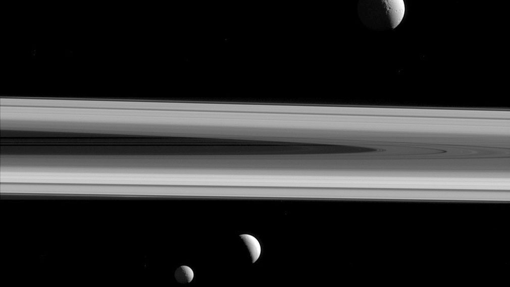 Three of Saturn's moons - Tethys, above, Enceladus, second left, and Mimas, seen from the Cassini spacecraft. (NASA)