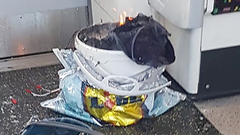 A white container was filmed burning inside a London Underground tube carriage at Parsons Green underground tube station after the attack. (Twitter/@sylvainpenne)