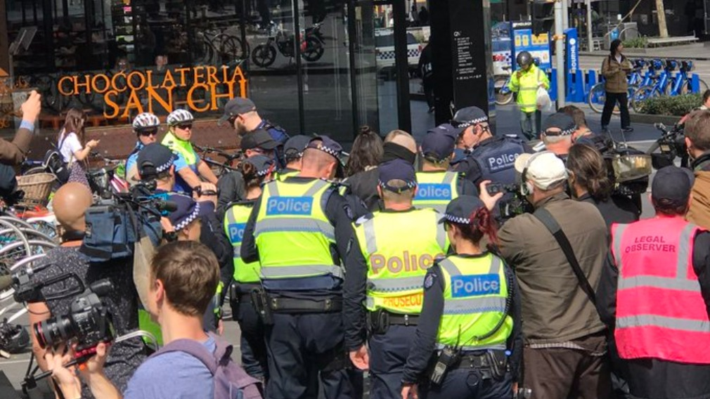 Man with mask at Melbourne rally charged