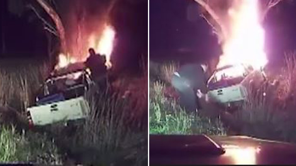 Hero risks his life to save stranger trapped in burning ute